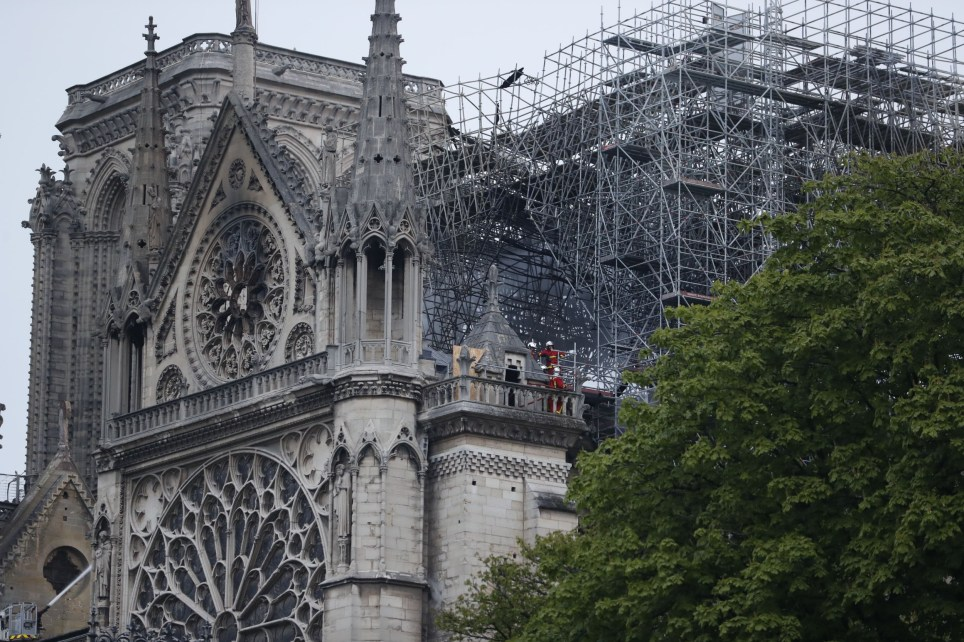 "Firefighters work to extinguish a fire at Notre-Dame Cathedral in Paris early on April 16, 2019. - A huge fire that devastated Notre-Dame Cathedral is ""under control"", the Paris fire brigade said early on April 16 after firefighters spent hours battling the flames. (Photo by Zakaria ABDELKAFI / AFP)ZAKARIA ABDELKAFI/AFP/Getty Images"