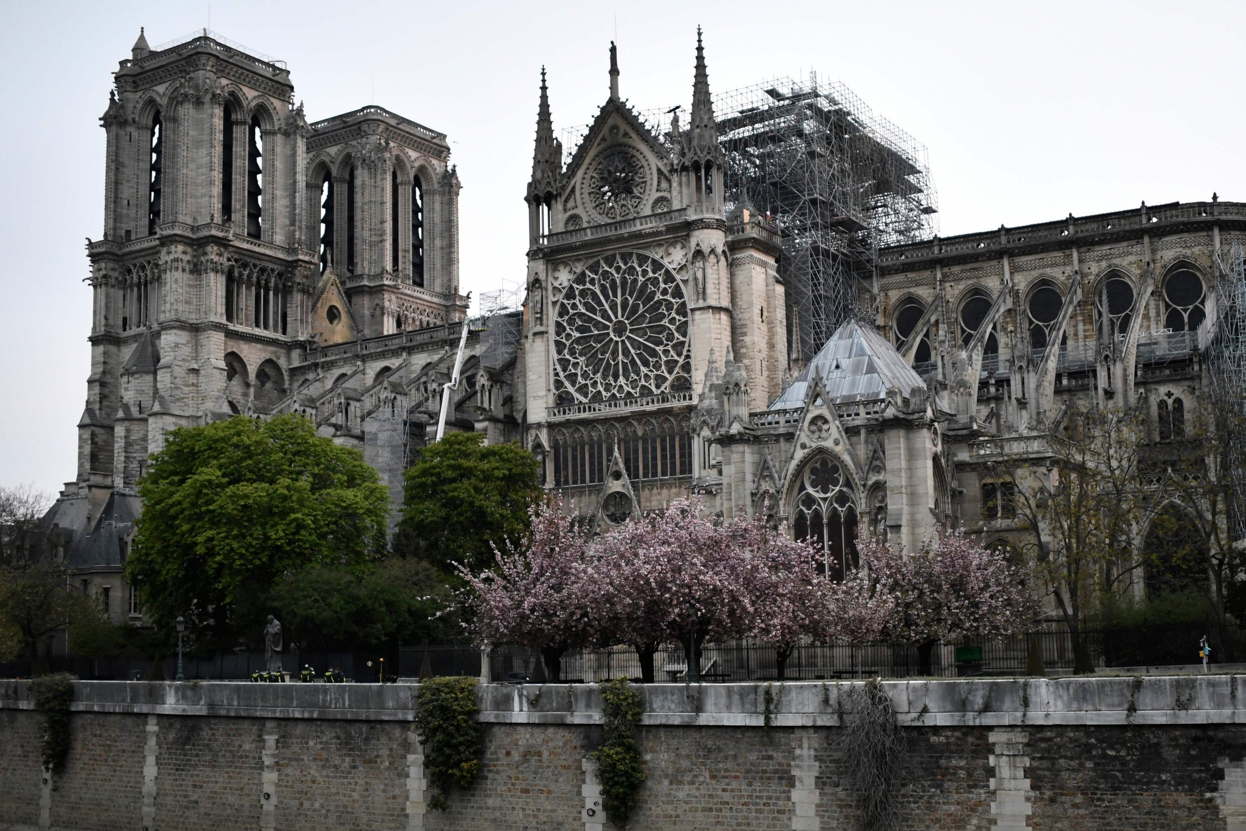 "Firefighters (below) work to extinguish a fire at Notre-Dame Cathedral in Paris early on April 16, 2019. - A huge fire that devastated Notre-Dame Cathedral is ""under control"", the Paris fire brigade said early on April 16 after firefighters spent hours battling the flames. (Photo by STEPHANE DE SAKUTIN / AFP)STEPHANE DE SAKUTIN/AFP/Getty Images"