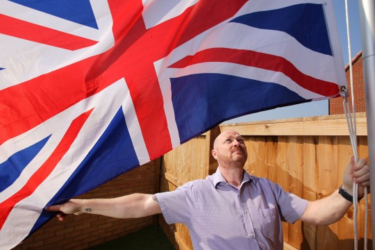 Ex-soldier Andrew Smith was told allegedly by a housing developer to stop flying his Union flag (Picture: Tom Maddick/SWNS)
