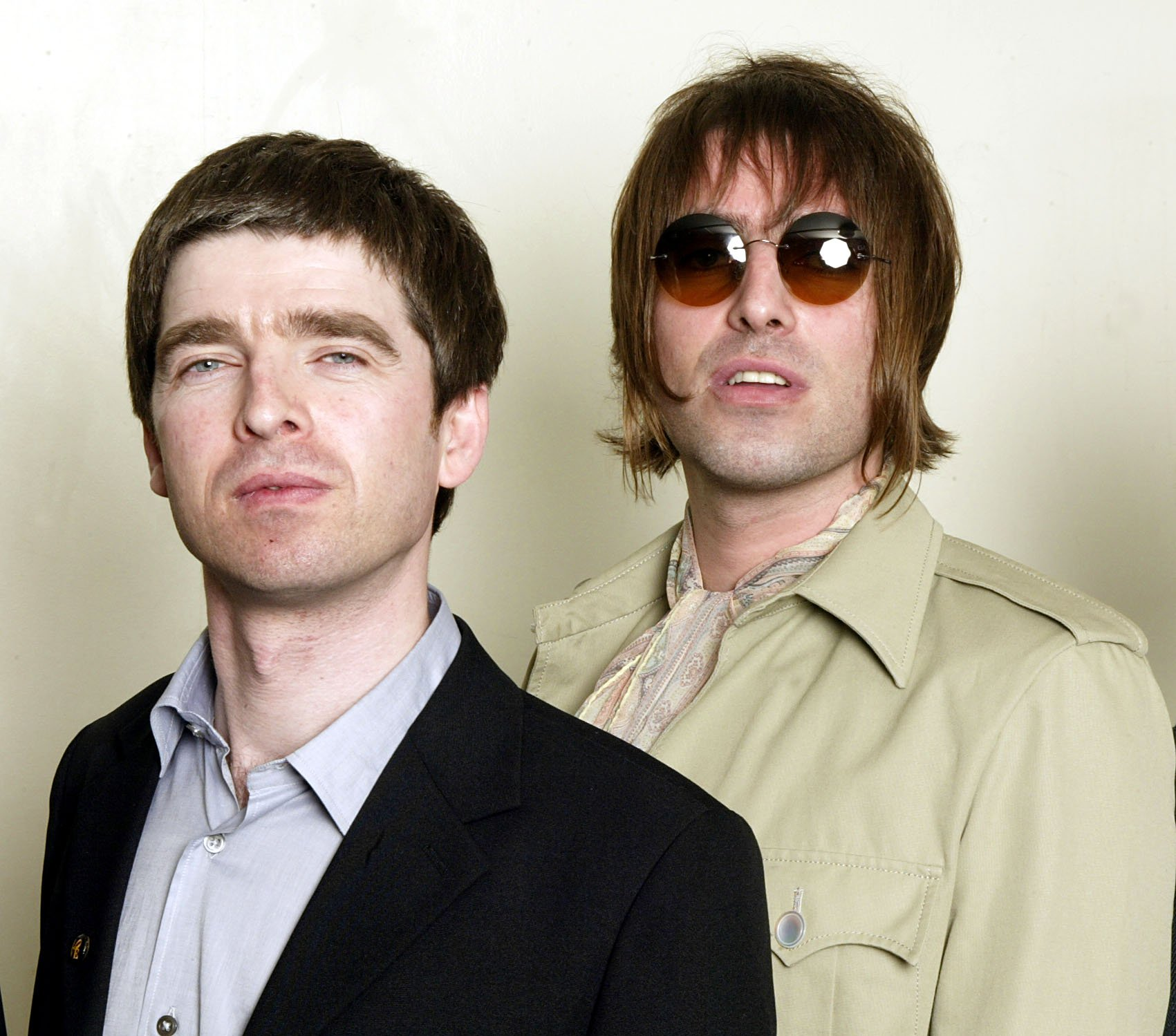 LONDON - MARCH 26: Noel and Liam Gallagher of rock band Oasis attend a charity concert for theTeenage Cancer Trust at the Royal Albert Hall on March 26, 2003 in London, England. Oasis performed at the event. (Photo by Dave Hogan/Getty Images)