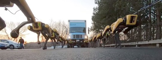 Legion of robot dogs display terrifying strength dragging along a truck Picture: BostonDynamics