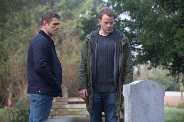 Sean Slater (Rob Kazinsky) and Jack Branning (Scott Maslen) at Roxy Mitchell's grave in EastEnders