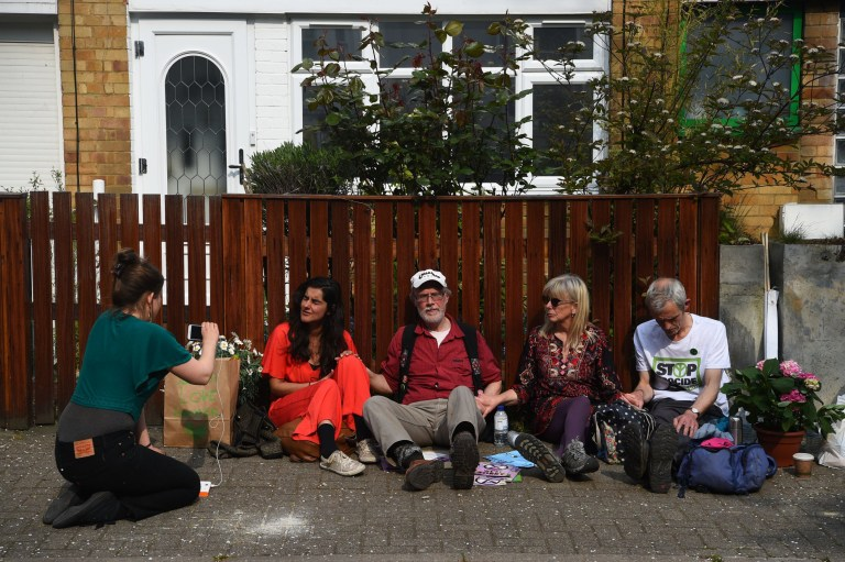 Climate activist who have glued themselves together sit outside Labour Party leader Jeremy Corbyn's house in north London. PRESS ASSOCIATION Photo. Picture date: Wednesday April 17, 2019. See PA story ENVIRONMENT Climate. Photo credit should read: Kirsty O'Connor/PA Wire
