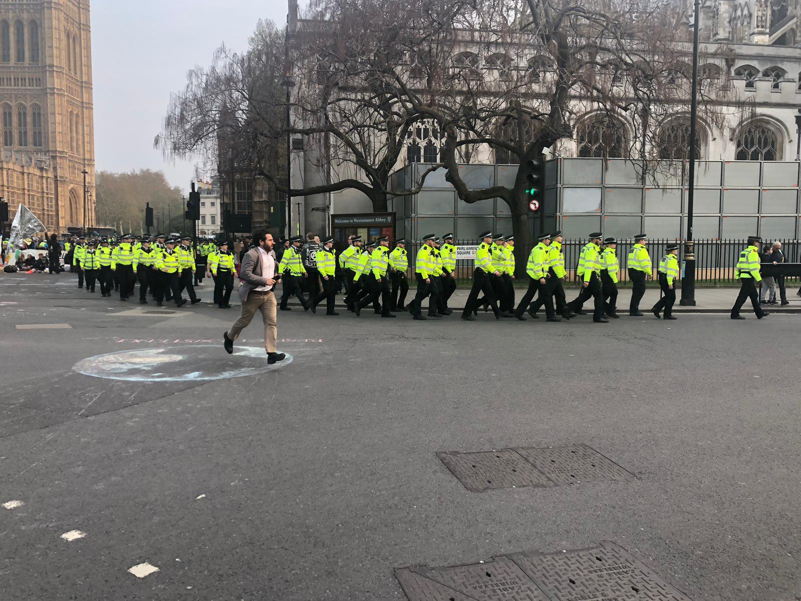 Hundreds of police storm Parliament Square to arrest climate change protesters