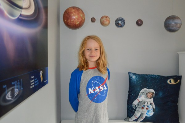 Pic by Suzi Fogels/Caters News (Pictured: Lily Fogels, 9 from Canberra, Australia has penned a letter to Target in Australia to make NASA clothes for girls as she is a massive space fan and only finds space clothes in the boys section.) - A little girl who dreams of becoming an astronaut has penned a heartfelt letter to Target begging them to make NASA clothing for girls after claiming she discovered only the boys section carried NASA clothes. Little Lily Fogels has been in love with all things space ever since she can remember and dreams of becoming an astronaut and living at the international space station when she grows up. SEE CATERS COPY
