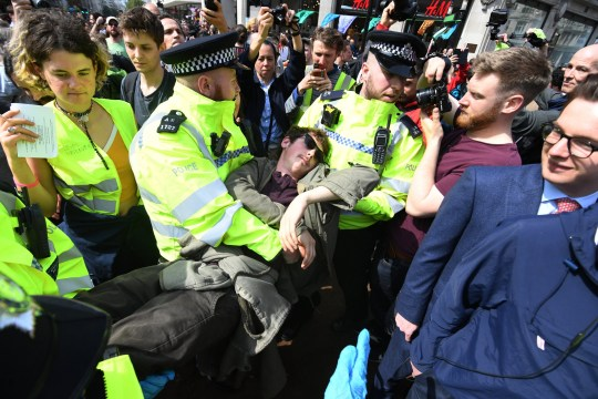 epa07513887 Activists are being arrested during Extinction Rebellion climate change protests on Oxford Circus, during climate change protests in London, Britain, 18 April 2019. The Waterloo Bridge remains closed as protests continue. EPA/FACUNDO ARRIZABALAGA