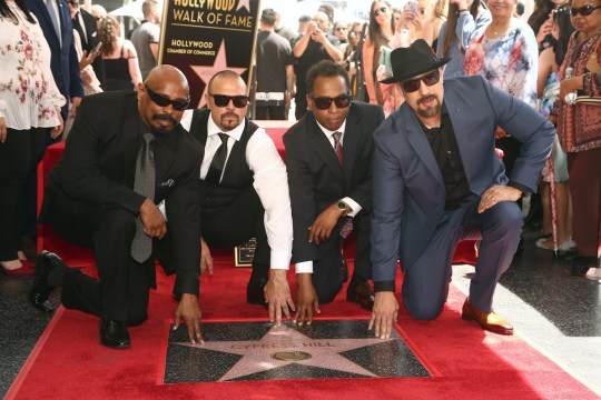 """HOLLYWOOD, CALIFORNIA - APRIL 18: Senen """"Sen Dog"""" Reyes, Lawrence """"DJ Muggs"""" Muggerud, Eric """"Bobo"""" Correa and Louis """"B-Real"""" Freese of Cypress Hill are honored with a star on The Hollywood Walk of Fame on April 18, 2019 in Hollywood, California. (Photo by Tommaso Boddi/WireImage)"""