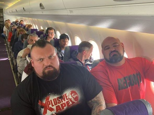 METRO GRAB INSTA Hilarious picture shows two World's Strongest Man champions looking far from impressed after being forced to squeeze into tiny economy seats next to each other on a plane Eddie Hall, who is six foot three inches, was sat next to Brian Shaw, six foot seven https://www.instagram.com/p/BwPatu_gNB5/