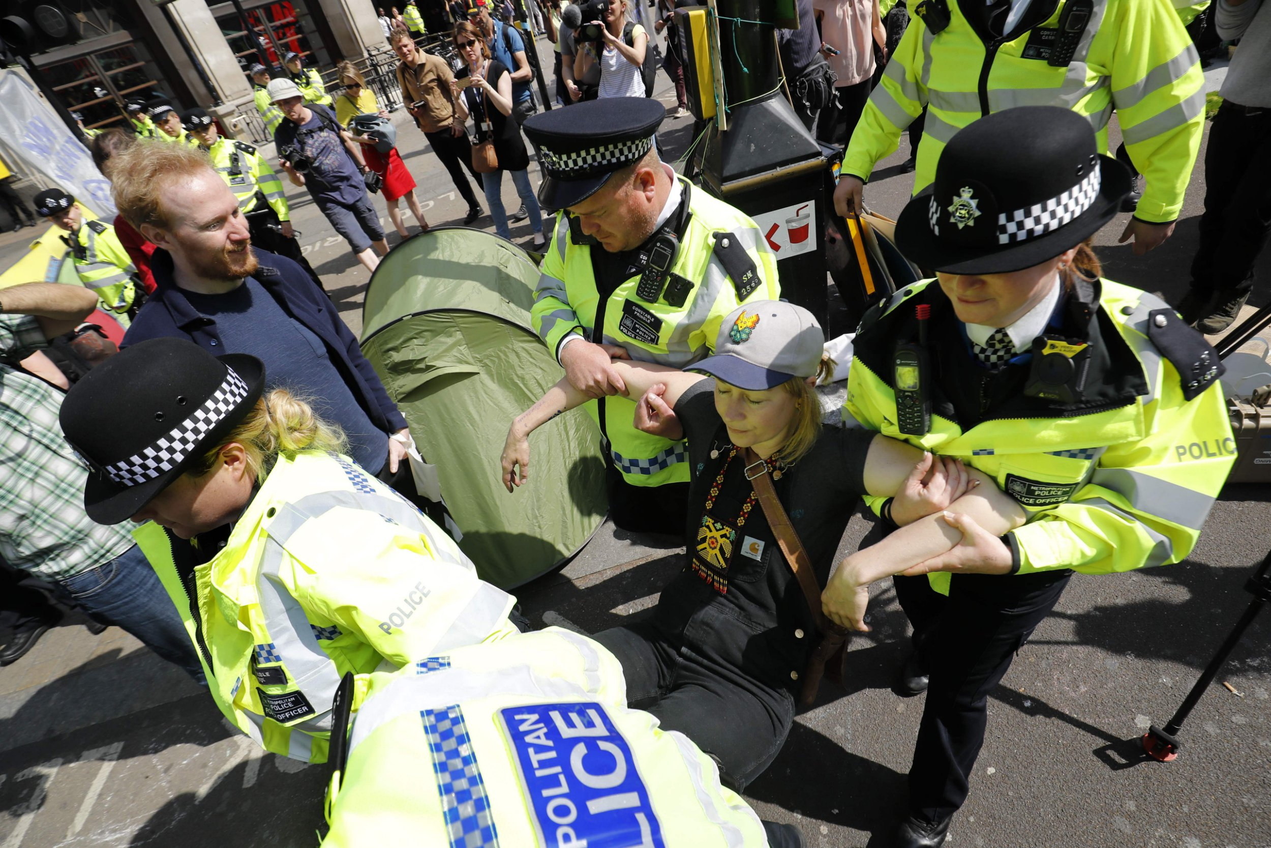 Police move in to remove protesters at Oxford Circus carrying activists away
