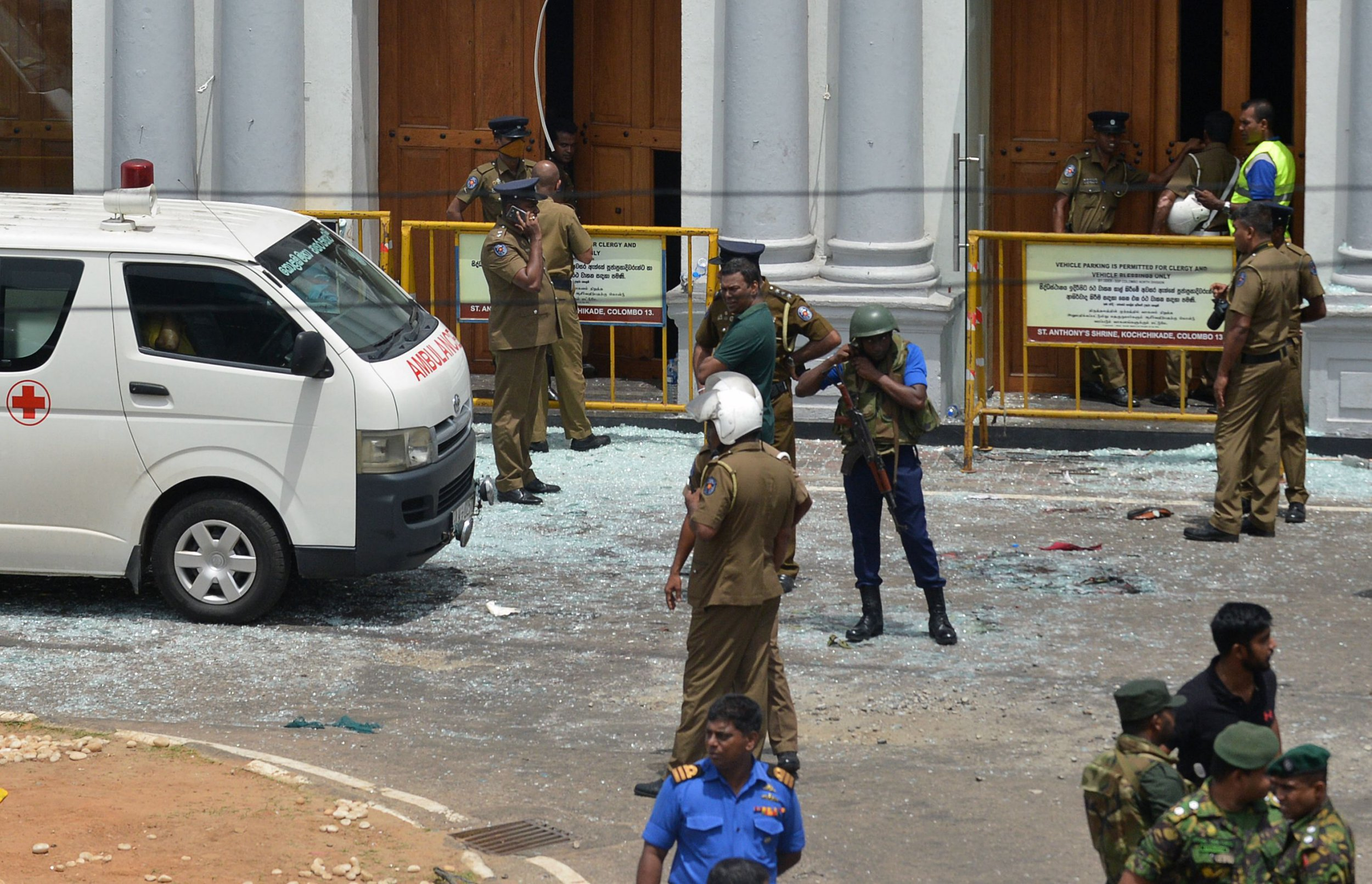 Sri Lankan security personnel stand next to an ambulance outside St. Anthony's Shrine in Kochchikade in Colombo on April 21, 2019 following a blast at the church. - At least 42 people were killed April 21 in a string of blasts at hotels and churches in Sri Lanka as worshippers attended Easter services, a police official told AFP. (Photo by ISHARA S. KODIKARA / AFP)ISHARA S. KODIKARA/AFP/Getty Images
