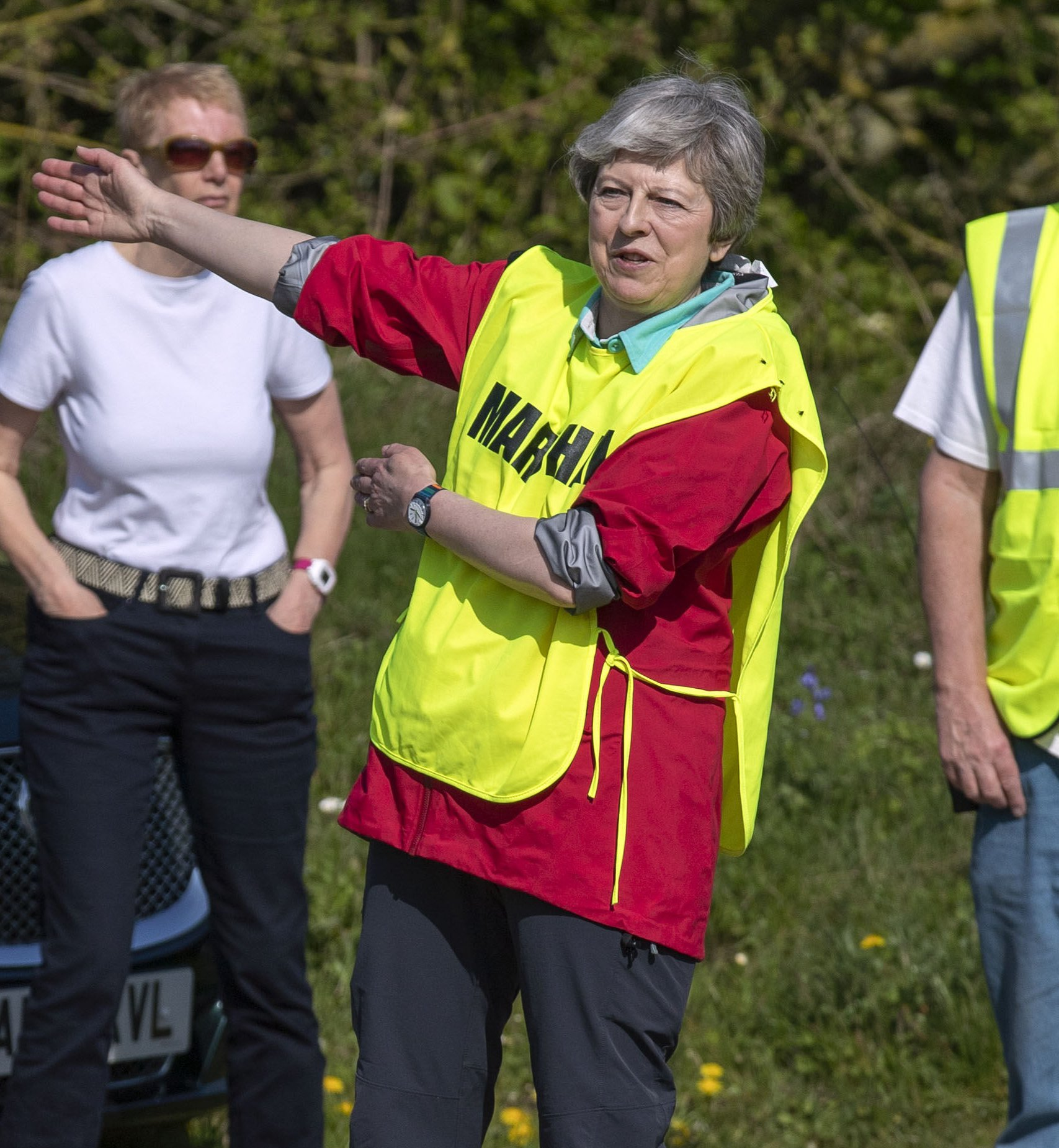 Prime Minister Theresa May acts as a marshal during the Maidenhead Easter 10 race in maidenhead. PRESS ASSOCIATION Photo. Picture date: Friday April 19, 2019. Photo credit should read: Steve Parsons/PA Wire