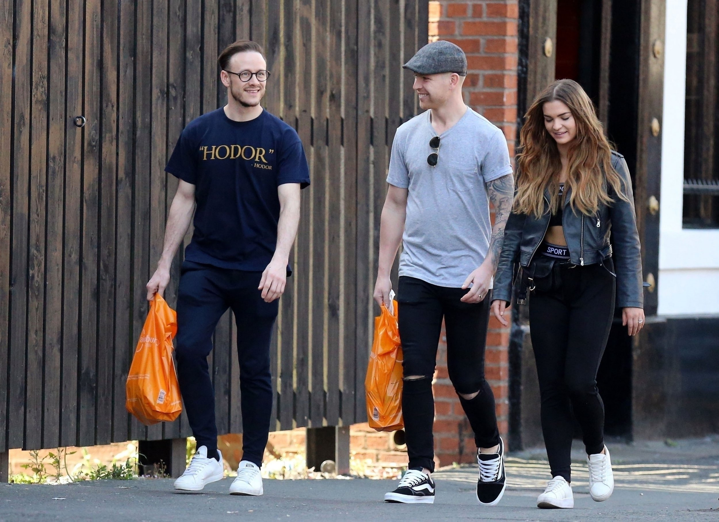 Kevin Clifton looks chuffed AF as he laughs with mates amid ex-wife's 'overdose' claims