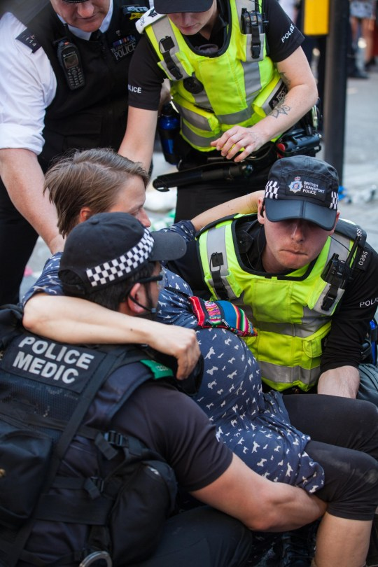 Alamy Live News. T54JE8 London, UK. 20th April 2019. Police officers remove Hanna, a seven-months pregnant climate change campaigner from Extinction Rebellion, who had locked herself to a fellow activist using an arm tube at Oxford Circus following a policing operation to clear it of protesters earlier in the day. The heart of London?s shopping district was blocked until late afternoon by lock-ons on the sixth day of International Rebellion activities to call on the British government to take urgent action to combat climate change. Credit: Mark Kerrison/Alamy Live News This is an Alamy Live News image and may not be part of your current Alamy deal . If you are unsure, please contact our sales team to check.