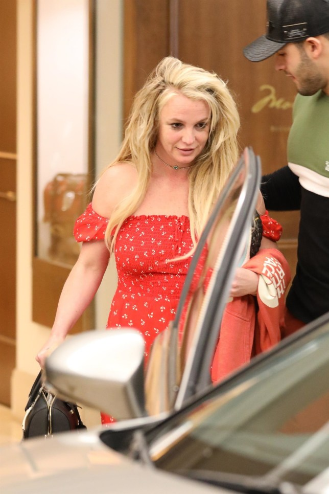 *PREMIUM-EXCLUSIVE* Beverly Hills, CA - Britney Spears leave The Montage in Beverly Hills after spending Easter with boyfriend Sam Asghari at the hotel. The singer emerged from the hotel looking relaxed and happy with Sam guiding her out and getting the door for her. It is the first time the singer has been seen since entering a wellness facility amid her father???s recovery from life threatening colon rupture. Spears has been taking time to care for herself as well during a very stressful time. The 37 year old mother of two spent a relaxing day at the upscale hotel with her longtime boyfriend. Britney appeared happy, smiling as she emerged and headed to her car in a summer dress and birkenstocks. Sam is clearly looking out for his longtime girlfriend, he made sure to walk ahead of her and see her to her car. The break with her longtime boyfriend seems to have put a smile back on her face. Spears took a break from her show ???Domination?????? in January in order to support her father during his recovery. Spears posted an emotional tweet with the announcement and reveling she would be there for her dad as he has ???always been there for me.'' Pictured: Britney Spears and Sam Asghari BACKGRID USA 22 APRIL 2019 USA: +1 310 798 9111 / usasales@backgrid.com UK: +44 208 344 2007 / uksales@backgrid.com *UK Clients - Pictures Containing Children Please Pixelate Face Prior To Publication*
