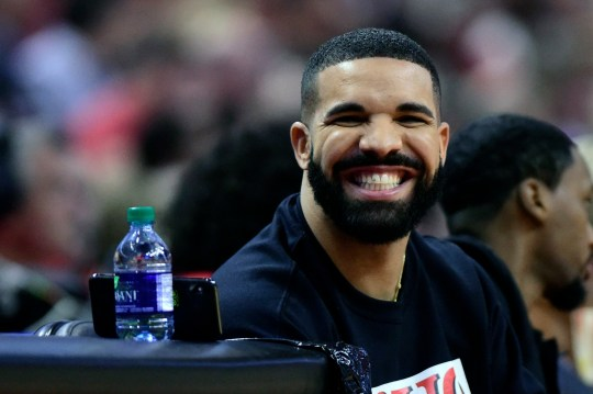 Drake smiles as he sits courtside during the first half in Game 5 of a first-round NBA basketball playoff series between the Toronto Raptors and Orlando Magic, Tuesday, April 23, 2019 in Toronto. (Frank Gunn/Canadian Press via AP)