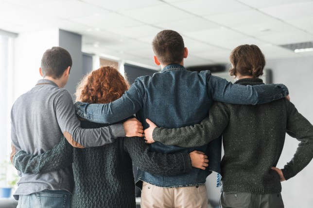 Group of business people embracing from behind; Shutterstock ID 1253728741; Purchase Order: -