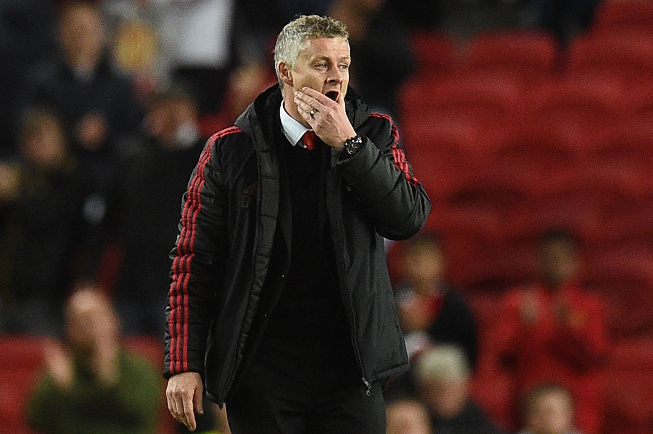 Manchester United's Norwegian manager Ole Gunnar Solskjaer reacts after a English Premier League football compare between Manchester United and Manchester City during Old Trafford in Manchester, north west England, on Apr 24, 2019. - Manchester City won a compare 2-0. (Photo by Oli SCARFF / AFP) / RESTRICTED TO EDITORIAL USE. No use with unapproved audio, video, data, tie lists, club/league logos or 'live' services. Online in-match use singular to 120 images. An additional 40 images might be used in additional time. No video emulation. Social media in-match use singular to 120 images. An additional 40 images might be used in additional time. No use in betting publications, games or singular club/league/player publications. / OLI SCARFF/AFP/Getty Images