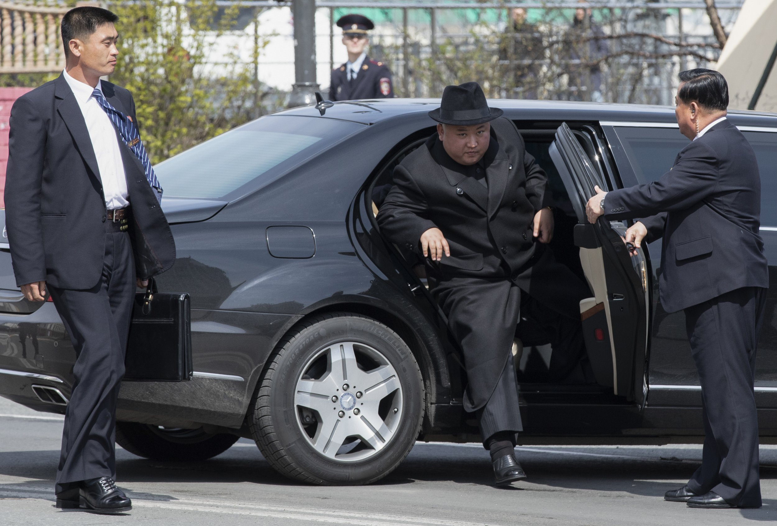 North Korean leader Kim Jong Un, center, arrives at the main train station to leave Russia in Vladivostok, Russia, Friday, April 26, 2019. North Korean leader Kim Jong Un paid his respects at a ceremony honoring the war dead Friday before wrapping up a brief and generally successful visit to the Russian Far East for his first summit with President Vladimir Putin. (AP Photo/Alexander Khitrov)