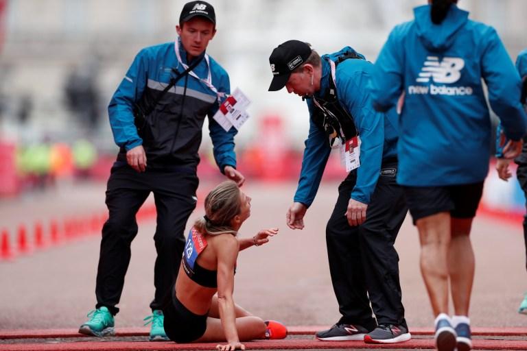 0fc7bdc781 Professional runner crawls over London Marathon finish line after ...