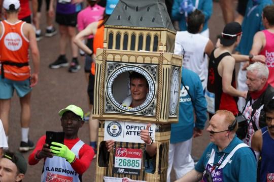 28th April 2019, London, England; The 2019 Virgin London Marathon; Marathon runner in Big Ben fancy celebrates after completing the marathon (Photo by John Patrick Fletcher/Action Plus via Getty Images)