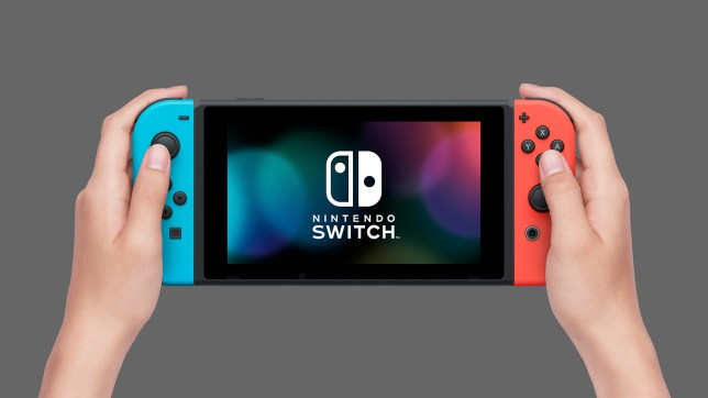 Hands holding the Nintendo Switch