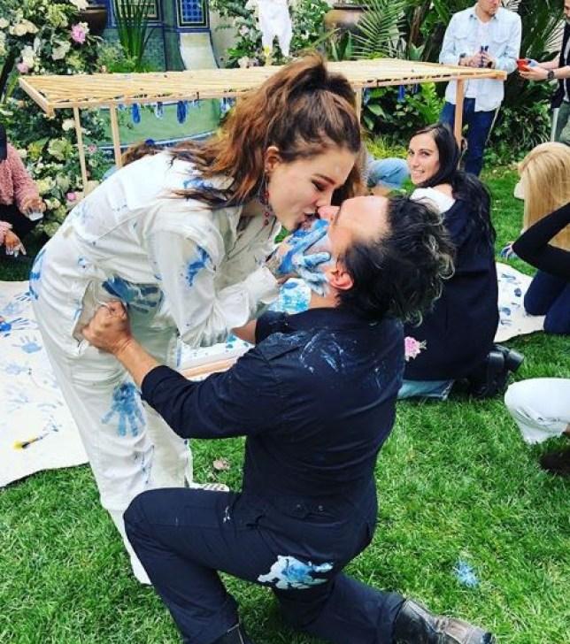 Alaina Meyer kissing Johnny Galecki at gender reveal party