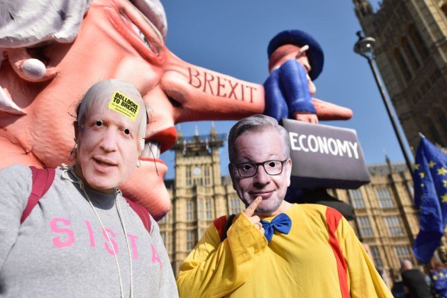 Brexit protesters in Boris Johnson and Michael Gove masks outside Westminster