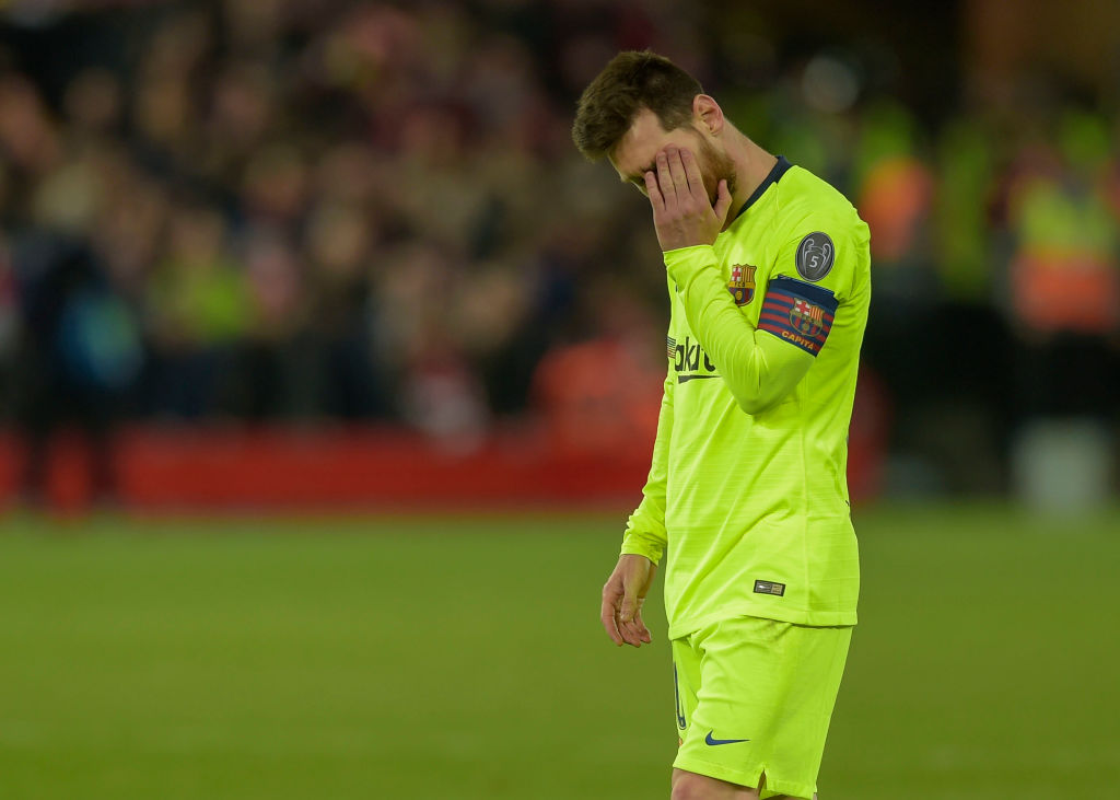 Lionel Messi inconsolable in the dressing room after defeat to Liverpool