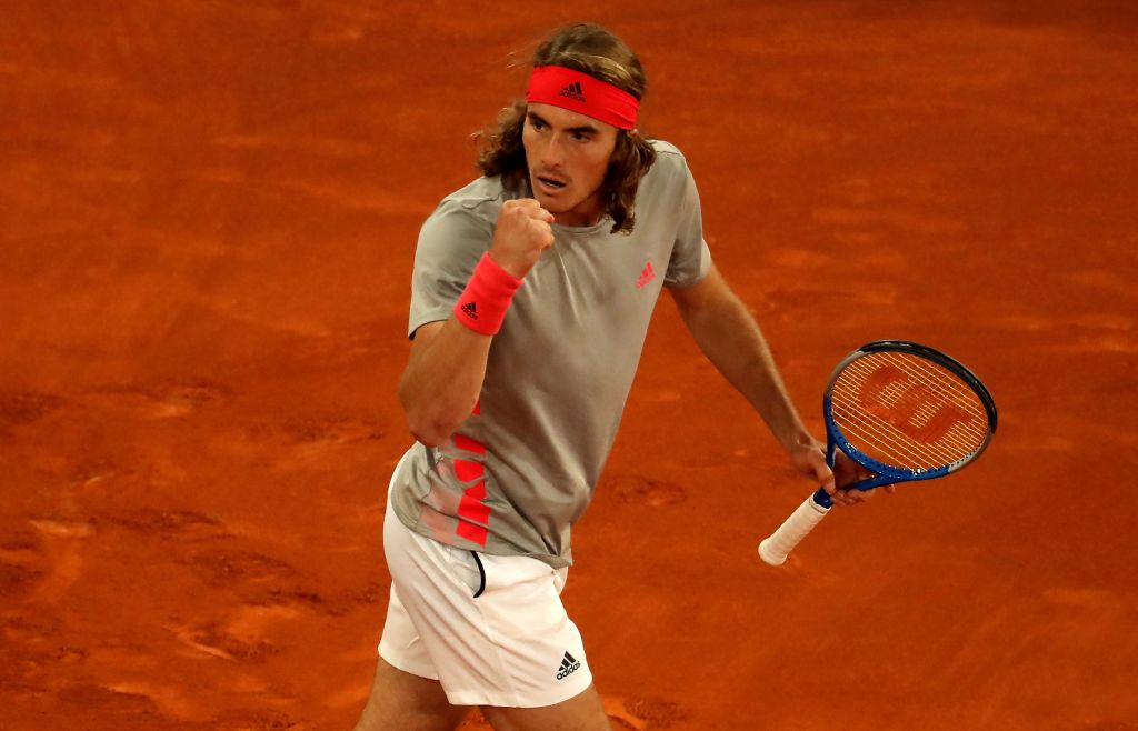 Stefanos Tsitsipas pumps his fist after beating Rafael Nadal to set up a tie with Novak Djokovic