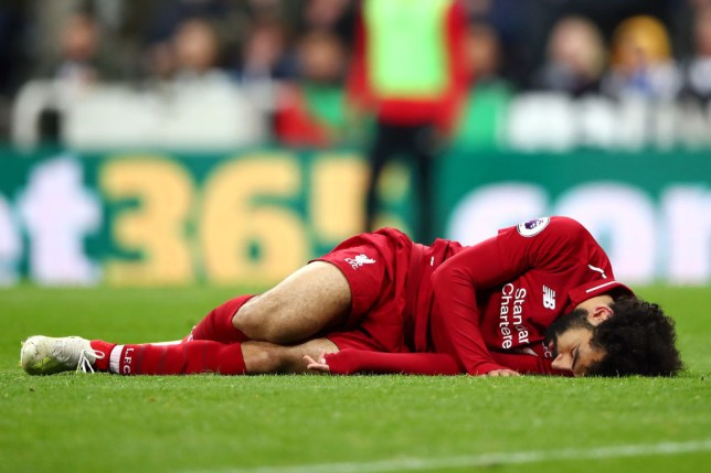 NEWCASTLE UPON TYNE, ENGLAND - MAY 04: Mohamed Salah of Liverpool goes down injured during the Premier League match between Newcastle United and Liverpool FC at St. James Park on May 04, 2019 in Newcastle upon Tyne, United Kingdom. (Photo by Clive Brunskill/Getty Images)