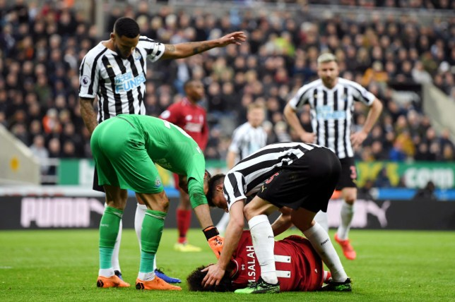NEWCASTLE UPON TYNE, ENGLAND - MAY 04: Mohamed Salah of Liverpool goes down injured during the Premier League match between Newcastle United and Liverpool FC at St. James Park on May 04, 2019 in Newcastle upon Tyne, United Kingdom. (Photo by Shaun Botterill/Getty Images)