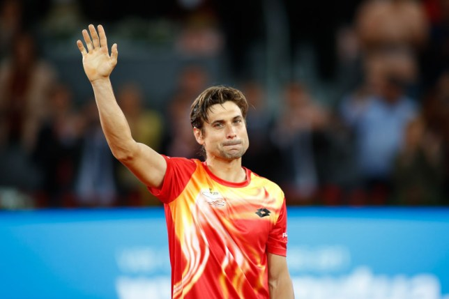 David Ferrer waving to the crowd after retiring