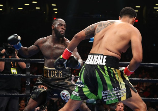 NEW YORK, NEW YORK - MAY 18: Deontay Wilder punches Dominic Breazeale during their bout for Wilder's WBC heavyweight title at Barclays Center on May 18, 2019 in New York City. (Photo by Al Bello/Getty Images)