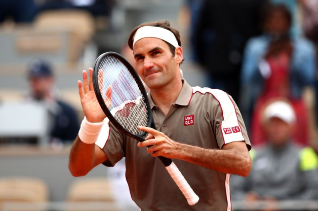 Roger Federer applauds the French Open crowd