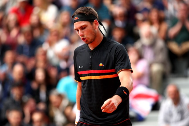 Cameron Norrie looks on after his French Open defeat