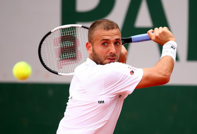 Dan Evans hits a backhand during his loss at the French Open
