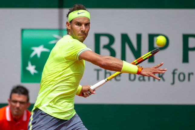 Rafael Nadal hits a forehand at the French Open