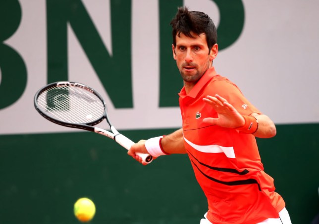 Novak Djokovic hits a forehand at the French Open