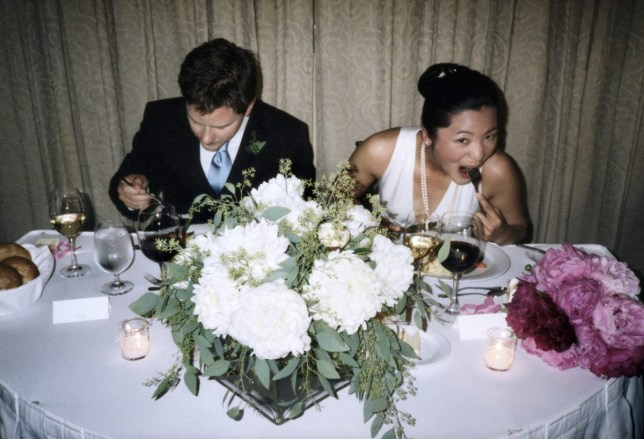 Bride and groom eating dinner at reception