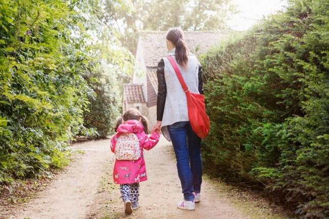 Mum taking child to school