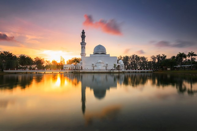 Tengku Tengah Zaharah Mosque or the Floating Mosque in Malaysia, in front of a sunset