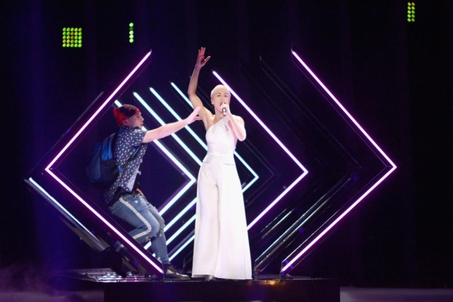 SuRie rushed by stage invader at Eurovision