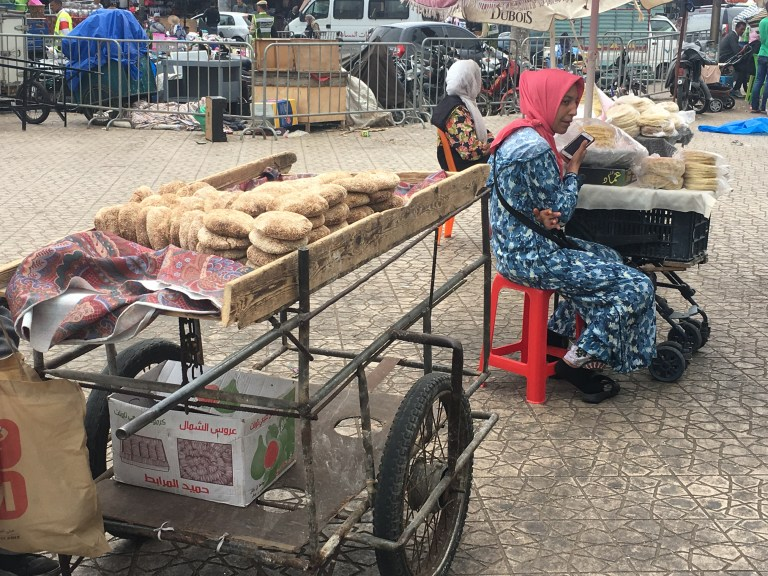 Woman sells bread by the side of the road in El Jadida
