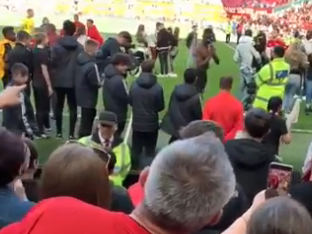 Paul Pogba clashes with angry Manchester United fans at Old Trafford after Cardiff defeat