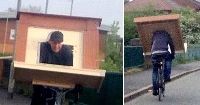 Cyclist rides down dual carriageway with fireplace over his head