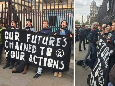 Young climate change protesters bike lock their necks to Parliament fence