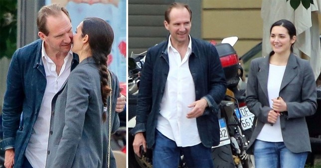 Ralph Fiennes gets close to brunette woman during break from