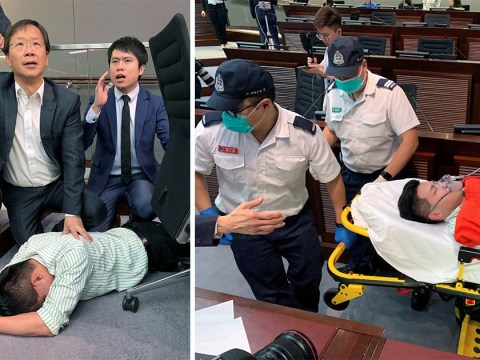 Chinese lawmaker collapses as brawl erupts in Hong Kong Parliament