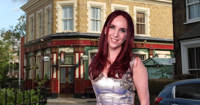Kate Oates standing in front of The Queen Victoria in EastEnders