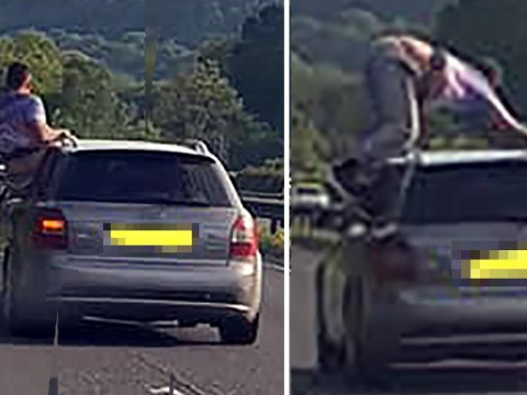 Man climbed on moving car and spread out in 'starfish' position